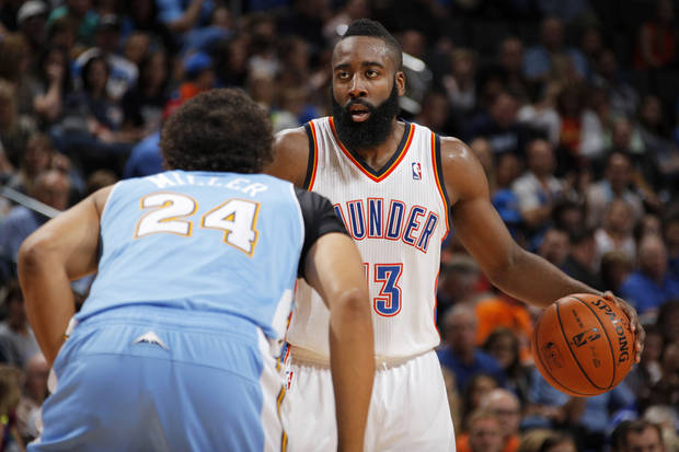 Oklahoma City's James Harden (13) goes up against Denver's Andre Miller (24) during the NBA preseason basketball game between the Oklahoma City Thunder and the Denver Nuggets at the Chesapeake Energy Arena, Sunday, Oct. 21, 2012. Photo by Garett Fisbeck, The Oklahoman