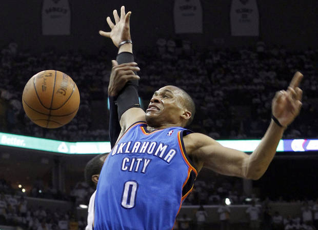 Oklahoma City Thunder guard Russell Westbrook (0) loses the ball as he is fouled by Memphis Grizzlies guard Mike Conley during the first half of Game 4 of a second-round NBA basketball playoff series Monday, May 9, 2011, in Memphis, Tenn. (AP Photo/Lance Murphey)