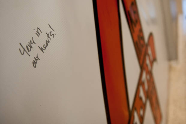 "A signature on the  ""Remember the 4"" banner Friday in Gallagher-Iba Arena in Stillwater.  Photo by Mitchell Alcala for The Okahoman <strong>Mitchell Alcala - Mitchell Alcala for the Oklahoma</strong>"