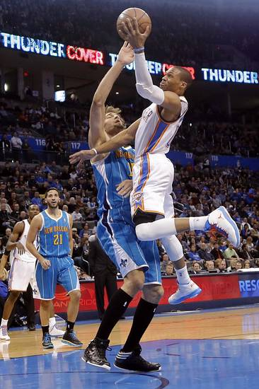 Oklahoma City Thunder&#039;s Russell Westbrook (0) drives past New Orleans Hornets&#039; Robin Lopez (15) during the NBA basketball game between the Oklahoma City Thunder and the New Orleans Hornets at the Chesapeake Energy Arena on Wednesday, Feb. 27, 2013, in Oklahoma City, Okla. Photo by Chris Landsberger, The Oklahoman