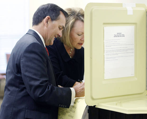 Randy Brogdon and his wife Donna vote in the Oklahoma primary election at Faith Lutheran Church in Owasso  July 27, 2010. MIKE SIMONS/Tulsa World
