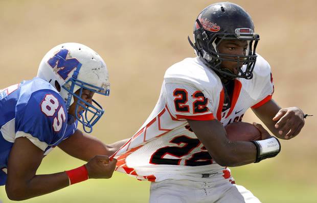 Millwood's Quincy Dotson tries to bring down Douglass' Chris High during the high school football game between Millwood and Douglass at Millwood High School in Oklahoma City, Saturday, Sept. 10, 2011. Photo by Sarah Phipps, The Oklahoman  ORG XMIT: KOD