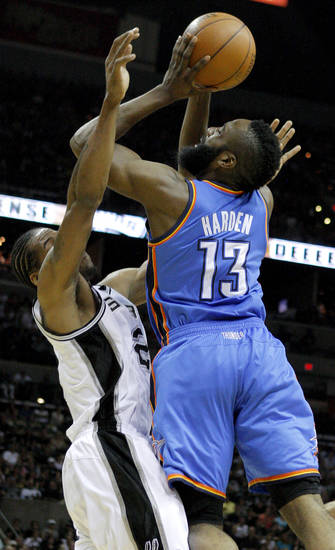 Oklahoma City's James Harden (13) tries to put up a shot as he runs into San Antonio's Kawhi Leonard (2) during Game 1 of the Western Conference Finals between the Oklahoma City Thunder and the San Antonio Spurs in the NBA playoffs at the AT&T Center in San Antonio, Texas, Sunday, May 27, 2012. Oklahoma City lost 101-98. Photo by Bryan Terry, The Oklahoman