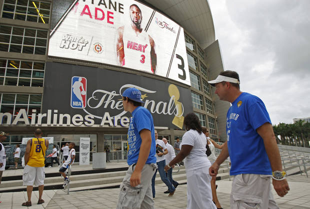 Tony Mussatto, at right, and his son, Joe Mussatto, 18, of Oklahoma City walk past the front of the arena before Game 4 of the NBA Finals between the Oklahoma City Thunder and the Miami Heat at American Airlines Arena, Tuesday, June 19, 2012. Photo by Bryan Terry, The Oklahoman