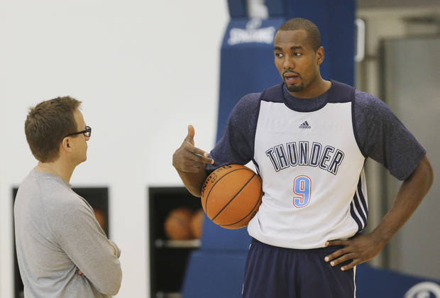 Head Coach Scott Brooks talks with Serge Ibaka during the shootaround at the Thunder Practice Facility in Oklahoma City, Monday April 21, 2014. The Oklahoma City Thunder will face the Memphis Grizzlies in game two Monday night. Photo By Steve Gooch, The Oklahoman