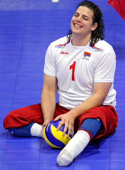 Serbia's Stevan Crnobrnja smiles with his teammates beofre he serves against Ukraine during the fourth day of competition at the World Sitting Volleyball championships on the University of Central Oklahoma campus in Edmond, Okla., on Wednesday, July 14, 2010. Photo by John Clanton, The Oklahoman