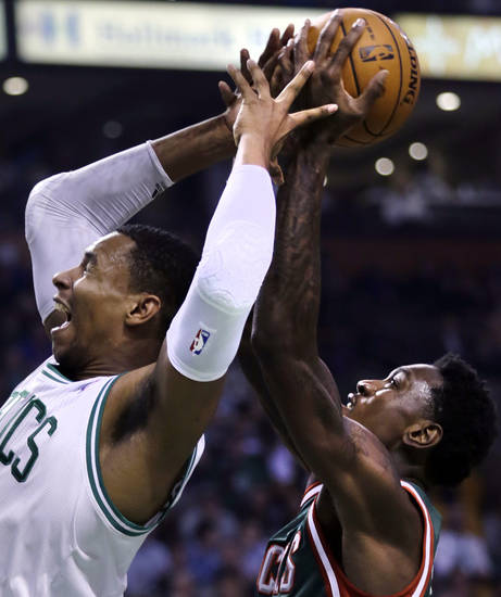 Boston Celtics forward Jeff Green, left, reaches back as Milwaukee Bucks forward Larry Sanders grabs the rebound in the first quarter of an NBA basketball game in Boston, Friday, Nov. 2, 2012. (AP Photo/Charles Krupa)