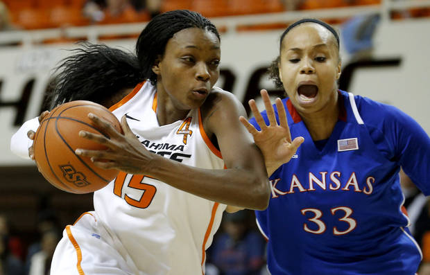 Oklahoma State&#039;s Toni Young (15) goes past Kansas&#039; Tania Jackson (33) during a women&#039;s college basketball game between Oklahoma State University (OSU) and Kansas at Gallagher-Iba Arena in Stillwater, Okla., Tuesday, Jan. 8, 2013. Oklahoma State won 76-59. Photo by Bryan Terry, The Oklahoman