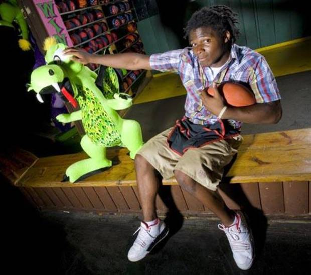 Carl Albert High School football player David Oku poses for a photo at Frontier City where he works in Oklahoma City, Wednesday, July 16, 2008. BY NATE BILLINGS, THE OKLAHOMAN