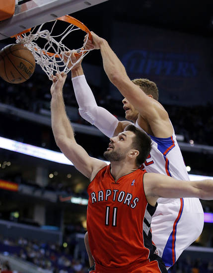 Los Angeles Clippers' Blake Griffin, top, dunks over Toronto Raptors' Linas Kleiza, of Lithuania, in the first half of an NBA basketball game in Los Angeles, Sunday, Dec. 9, 2012. (AP Photo/Jae C. Hong)