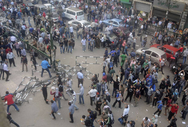   Egyptian protesters gather outside the country&#039;s high court in Cairo, Egypt, Saturday, Nov. 24, 2012. Egypt&acirc;s highest body of judges slammed on Saturday a recent decision by the president to grant himself near-absolute power, calling the move an &acirc;unprecedented assault&acirc; on the judiciary. The statement from the Supreme Judicial Council came as hundreds of demonstrators clashed with police outside a downtown Cairo courthouse. They were protesting the Thursday declaration by President Mohammed Morsi that courts could not overrule his decrees until a new constitution and parliament is in place, several months if not more in the future. (AP Photo/Mohammed Asad)  