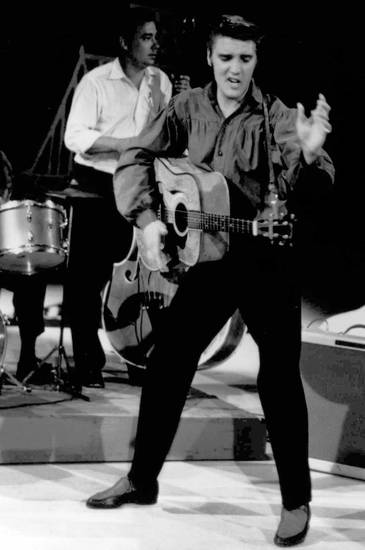 "Elvis Presley performs on the ""Ed Sullivan Show"" in this Sept. 9, 1956, file photo, which was his first of several appearances on the CBS show.  (AP Photo/Museum of Television & Radio/FILE)"