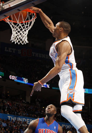 Oklahoma City's Russell Westbrook (0) dunks the ball in front of Detroit's Ben Wallace (6) during the NBA basketball game between the Detroit Pistons and Oklahoma City Thunder at the Chesapeake Energy Arena in Oklahoma City, Monday, Jan. 23, 2012. Photo by Nate Billings, The Oklahoman