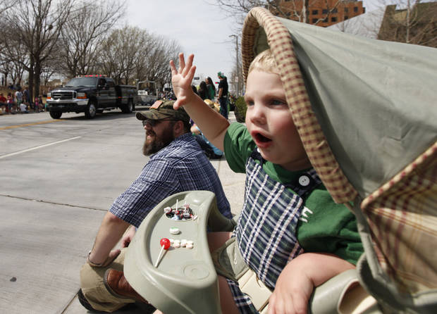 Two year old Seamus Carter waves from his stroller during the annual Saint Patrick's Day Parade in downtown Oklahoma City, OK, Saturday, March 16, 2013,  By Paul Hellstern, The Oklahoman