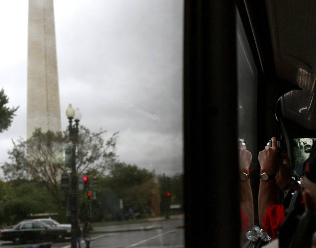 A Guardian on an Oklahoma Honor Flight photographs the Washington Monument from the tour bus window in Washington D.C. on Wednesday, Oct. 12, 2011. Veterans from Oklahoma visited the National WWII Memorial during an Oklahoma Honor Flight to Virginia and Washington D.C. on Wednesday. Photo by John Clanton, The Oklahoman