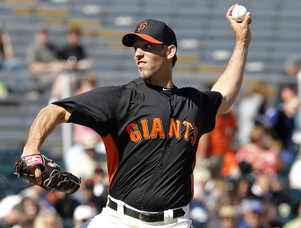 San Francisco Giants pitcher Madison Bumgarner delivers a pitch against the Chicago White Sox during the first inning of a spring training baseball game, Monday, Feb. 25, 2013, in Scottsdale, Ariz. (AP Photo/Matt York)