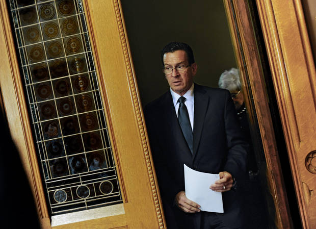 Governor Dannel P. Malloy arrives for a media briefing at the Capitol in Hartford, Conn., Monday, Dec. 17, 2012.  A gunman walked into Sandy Hook Elementary School in Newtown, Conn., Friday and opened fire, killing 26 people, including 20 children.(AP Photo/Jessica Hill) ORG XMIT: CTJH104