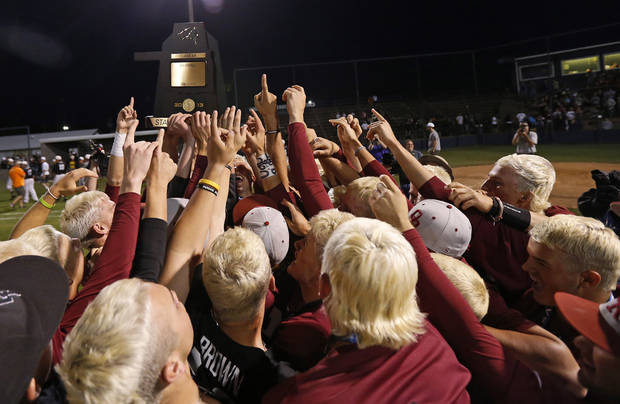 Owasso hoists the trophy after winning the Class 6A state baseball tournament championship game over Norman North in Shawnee, Okla., Saturday, May 11, 2013. Photo by Bryan Terry, The Oklahoman