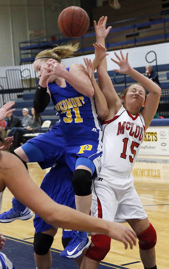 Piedmont's Alex Hall (31) and McLoud's Brook Johnson (15) fight for a rebound during a basketball tournament at the Kingfisher High School gym on Thursday, Jan. 24, 2013, in Kingfisher, Okla.  Photo by Chris Landsberger, The Oklahoman