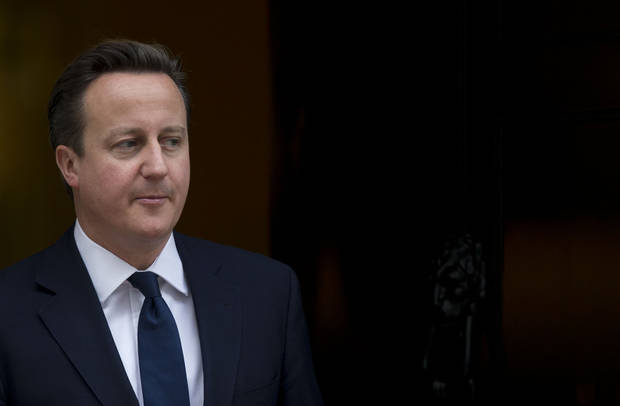   Britain&#039;s Prime Minister David Cameron walks out the front door of 10 Downing Street in London, to greet the Emir of Kuwait Sheikh Sabah al-Ahmad al-Sabah during his State Visit to the UK, Wednesday, Nov. 28, 2012. The judge who spent a year investigating the misdeeds of Britain&#039;s lively newspapers is giving Prime Minister David Cameron an early look at his recommendations for the regulation of the press. Officials say Cameron will get a copy of Lord Justice Brian Leveson&#039;s report Wednesday, a day before the public sees it, but Cameron is already being besieged with advice about how to respond to the still-secret recommendations. (AP Photo/Matt Dunham)  