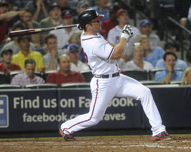 Atlanta Braves Dan Uggla hits a home run against the Kansas City Royals during the eighth inning of a baseball game, Tuesday, April 16, 2013, in Atlanta. Atlanta won 6-3.(AP Photo/John Amis)