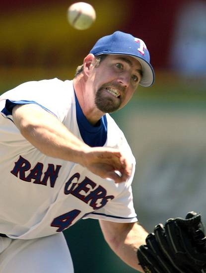 MAJOR LEAGUE BASEBALL: Texas Rangers relief pitcher R.A. Dickey throws against the Boston Red Sox in Arlington, Texas, Thursday, April 24, 2003. Dickey, who was taken by Texas in the first round of the 1996 amateur draft, got his first major league victory pitching three innings in relief Thursday as Texas beat Boston 16-5. (AP Photo/Star-Telegram, Ron Jenkins)