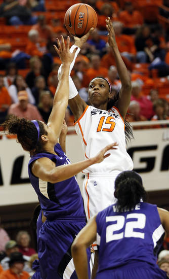Oklahoma State's Toni Young (15) shoots against Kansas State's Chantay Caron (11) as Mariah White (22) looks on during an NCAA women's basketball game between Oklahoma State University (OSU) and Kansas State at Gallagher-Iba Arena in Stillwater, Okla., Saturday, Feb. 16, 2013. Photo by Nate Billings, The Oklahoman