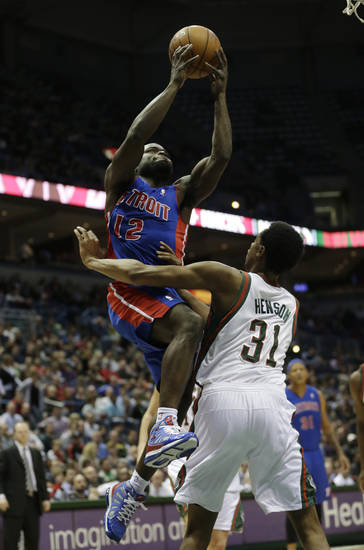 Detroit Pistons point guard Will Bynum goes up against Milwaukee Bucks forward John Henson (31) during the first half of an NBA basketball game Friday, Jan. 11, 2013, in Milwaukee. (AP Photo/Morry Gash)
