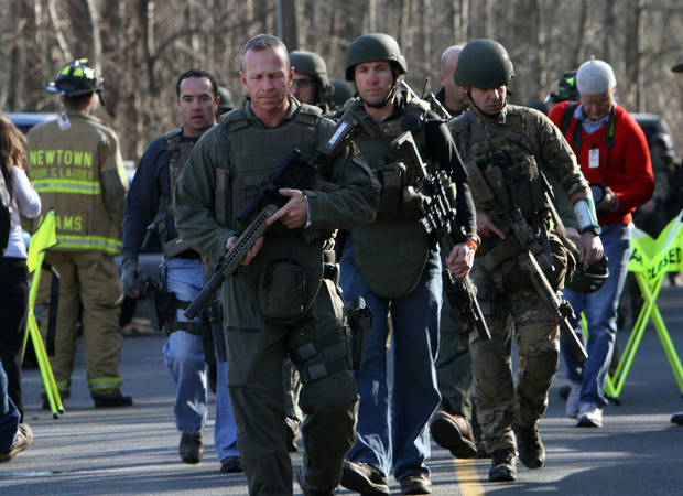 Heavily armed Connecticut State troopers are on the scene at Sandy Hook Elementary School in Newtown, Conn. where authorities say a gunman opened fire, leaving 27e people dead, including 20 children, Friday, Dec. 14, 2012. (AP Photo/The Journal News, Frank Becerra Jr.) MANDATORY CREDIT, NYC OUT, NO SALES, TV OUT, NEWSDAY OUT; MAGS OUT