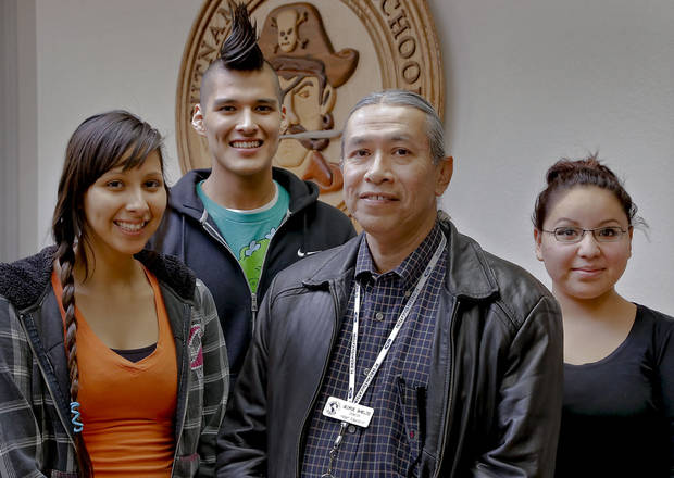 Putnam City Indian Education organization members, from left, Sydney Keith, Celo Keith, instructor George Shields and Jessica Hulbutta.  Photo by Chris Landsberger, The Oklahoman <strong>CHRIS LANDSBERGER - CHRIS LANDSBERGER</strong>