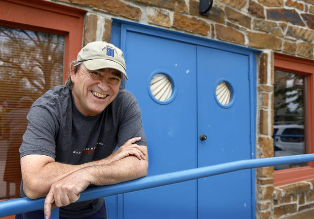 Blue Door proprietor Greg Johnson poses for a photo May 6 at the beloved listening room, 2805 N McKinley, which is celebrating its 20th anniversary. Photo by Jim Beckel, The Oklahoman <strong>Jim Beckel</strong>