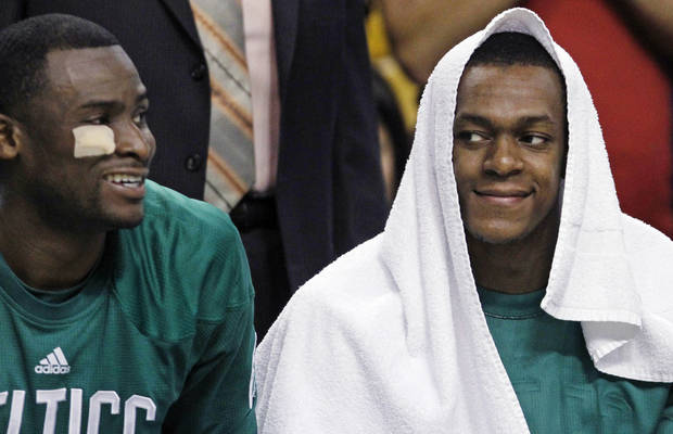 Boston Celtics point guard Rajon Rondo, right, smiles as he sits on the bench with guard Keyon Dooling during the second half of an NBA basketball game against the Milwaukee Bucks in Boston, Thursday, April 26, 2012. The Celtics won 87-74. (AP Photo/Charles Krupa)