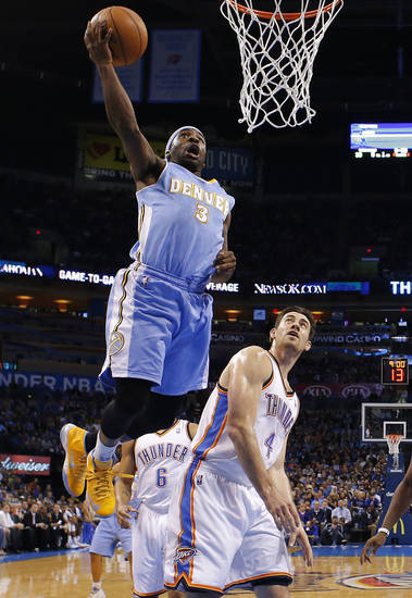 Denver's Ty Lawson (3) goes past Oklahoma City's Nick Collison (4) during an NBA basketball game between the Oklahoma City Thunder and the Denver Nuggets at Chesapeake Energy Arena in Oklahoma City, Tuesday, March 19, 2013. Denver won 114-104. Photo by Bryan Terry, The Oklahoman