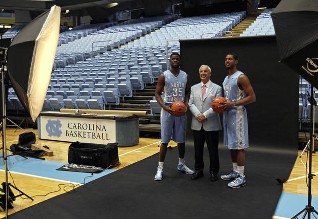 North Carolina's Reggie Bullock (35) and Leslie McDonald (2) pose with coach Roy Williams during the team's NCAA college basketball media day in Chapel Hill, N.C., Thursday, Oct. 11, 2012. (AP Photo/Gerry Broome)