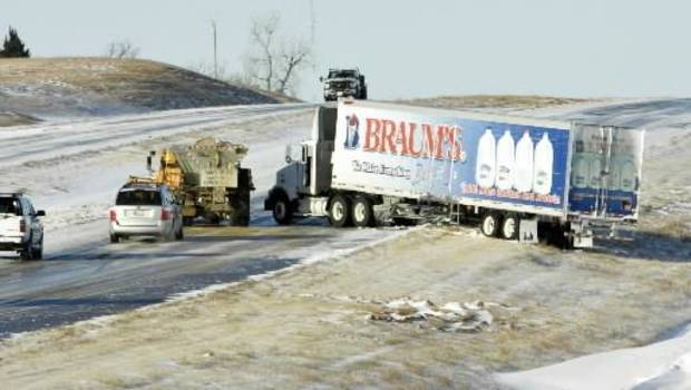 A truck slides off westbound Highway 9 on Friday, Dec. 25, 2009, in Newcastle, Okla. Photo by  Steve  Sisney