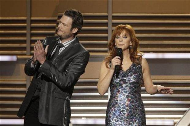 Blake Shelton and Reba co-host the April 3 Academy of Country Music Awards. The Oklahoma natives are planning a May 26 benefit show in Durant to raise funds for tornado relief in Atoka County. (AP file photo)