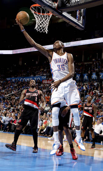 Oklahoma City's Kevin Durant (35) shoots a lay up during the NBA basketball game between the Oklahoma City Thunder and the Portland Trail Blazers at Chesapeake Energy Arena in Oklahoma City, Sunday, March 18, 2012. Photo by Sarah Phipps, The Oklahoman.