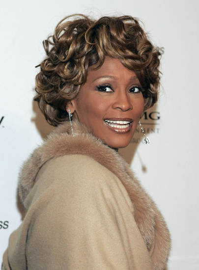 Whitney Houston arrives for the Clive Davis Pre-Grammy Party in Beverly Hills, Calif., Saturday, Feb. 10, 2007.  The 49th Annual Grammy Awards will air live on Sunday, Feb. 11 at the Staples Center in Los Angeles.  (AP Photo/Danny Moloshok)  ORG XMIT: CADB149
