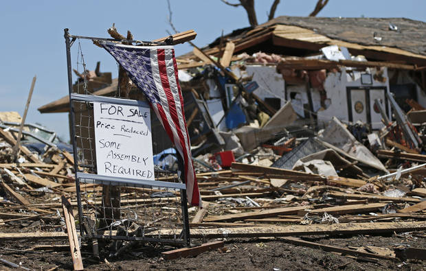 A sign outside a home in Moore, Okla., Wednesday, May 22, 2013. A tornado damaged the area on Monday, May 20, 2013. Photo by Bryan Terry, The Oklahoman