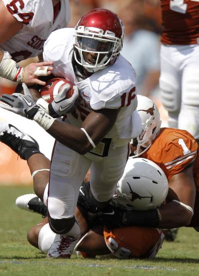 Oklahoma's Jaz Reynolds (16) fights for more yards during the Red River Rivalry college football game between the University of Oklahoma Sooners (OU) and the University of Texas Longhorns (UT) at the Cotton Bowl in Dallas, Saturday, Oct. 8, 2011. Oklahoma won 55-17 Photo by Bryan Terry, The Oklahoman