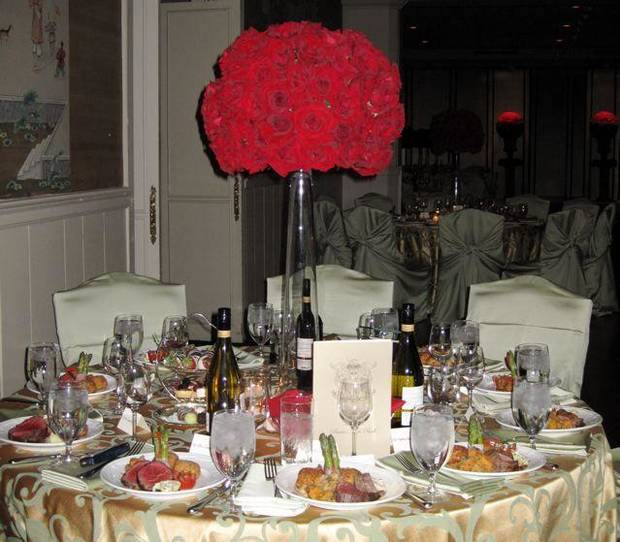 BEAUX ARTS BALL....Red rose balls decorated the dinner tables. (Photo  by Helen Ford Wallace).