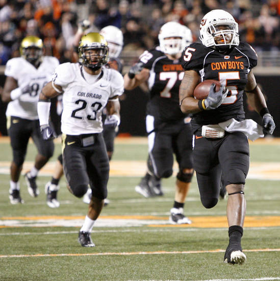 Keith Toston runs past Colorado&#039;s Jalil Brown in his way to a touchdown in the third quarter of the college football game between Oklahoma State University (OSU) and the University of Colorado (CU) at Boone Pickens Stadium in Stillwater, Okla., Thursday, Nov. 19, 2009. Photo by Bryan Terry, The Oklahoman