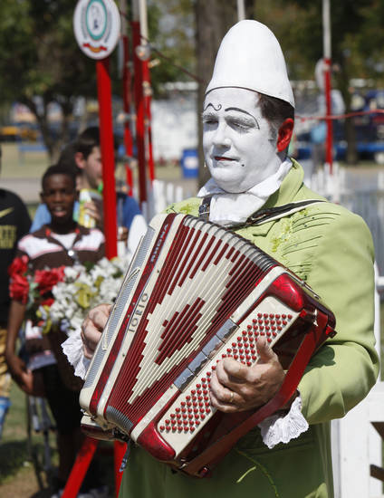 """Papino"", also known as Jay Walther, welcomes visitors to the Zoppe Italian Family Circus, during the Oklahoma State Fair at State Fair Park in Oklahoma City, OK, Thursday, September 20, 2012,  By Paul Hellstern, The Oklahoman"