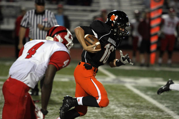 Norman quarterback Zach Longs breaks free for a 54 yard run during the Lawton - Norman High School football game at Harve Collins Field at Norman High School in Norman Friday night. PHOTO BY HUGH SCOTT FOR THE OKLAHOMAN ORG XMIT: KOD