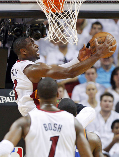 Miami's Dwyane Wade (3) takes a shot during Game 3 of the NBA Finals between the Oklahoma City Thunder and the Miami Heat at American Airlines Arena, Sunday, June 17, 2012. Photo by Bryan Terry, The Oklahoman