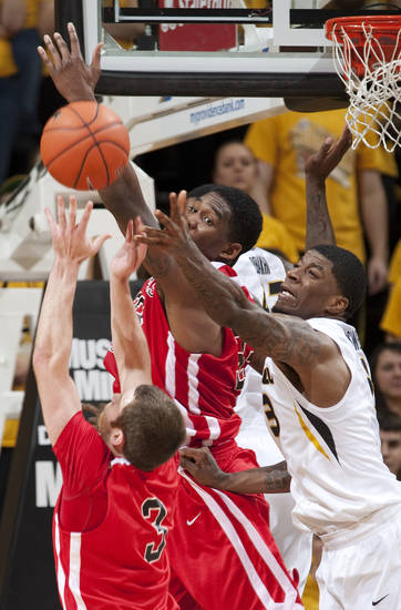 Missouri's Tony Criswell, right, fights off Southeast Missouri State's Nick Niemczyk, bottom left, and Tyler Stone, top, for a rebound during the second half of an NCAA college basketball game Tuesday, Dec. 4, 2012, in Columbia, Mo. Missouri won 81-65. (AP Photo/L.G. Patterson)