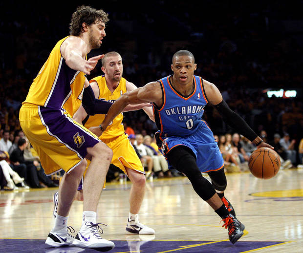 Oklahoma City's Russell Westbrook (0) drives to the basket past Los Angeles' Pau Gasol (16) and Steve Blake (5) during Game 3 in the second round of the NBA basketball playoffs between the L.A. Lakers and the Oklahoma City Thunder at the Staples Center in Los Angeles, Friday, May 18, 2012. Photo by Nate Billings, The Oklahoman