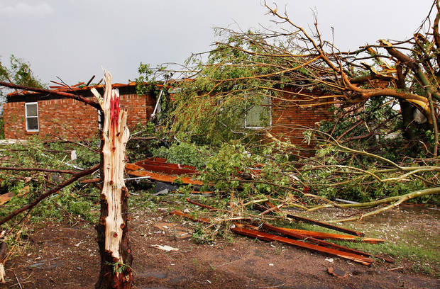 Fallen trees litter the yard of this home on SH 74F near Cashion after a tornado raced across Logan County  Tuesday afternoon,  May 24, 2011,   The home's roof was pulled away and more than a dozen trees on the property were knocked down. Photo by Jim Beckel, The Oklahoman