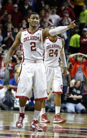 Oklahoma's Steven Pledger (2) gestures at the close of the second half as the University of Oklahoma Sooners (OU) defeat the Kansas Jayhawks (KU) 72-66 in NCAA, men's college basketball at The Lloyd Noble Center on Saturday, Feb. 9, 2013 in Norman, Okla. Photo by Steve Sisney, The Oklahoman