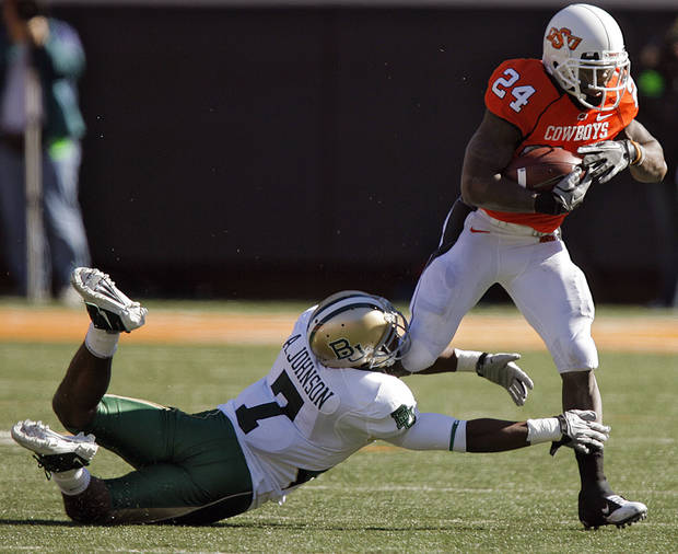 Oklahoma State's Kendall Hunter (24) runs past Baylor's Antonio Johnson (7) during the college football game between the Oklahoma State University Cowboys (OSU) and the Baylor University Bears at Boone Pickens Stadium in Stillwater, Okla., Saturday, Nov. 6, 2010. Photo by Chris Landsberger, The Oklahoman